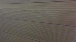 鶴弥、瓦の特性を活かした陶板壁材を開発